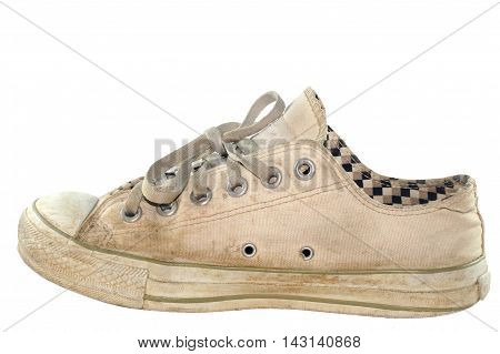 vintage age-worn sneakers on a white background