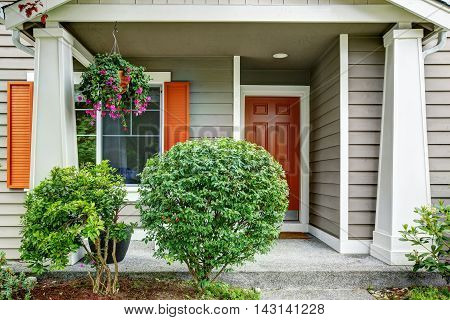 Front Red Entry Door Exterior. House With Siding Trim