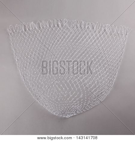 Harvest gear of white cloth mesh for fishing on grey background