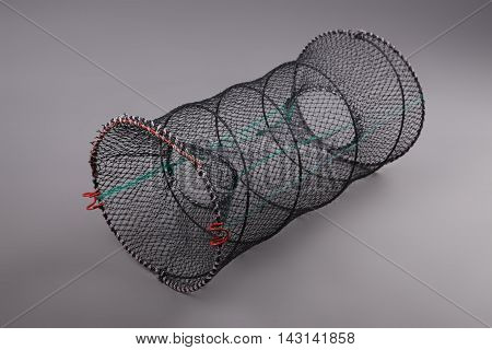 Harvest gear of round grid for fishing tackle on grey background