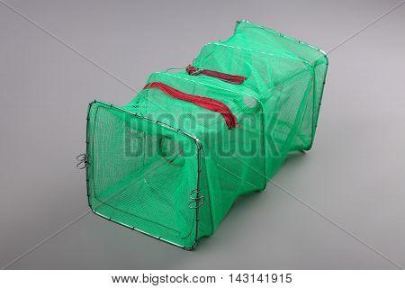 Harvest gear of rectangular shrimp cage for fishing tackle on grey background