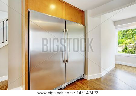 Large Steel Fridge For A Large Family Built-in Kitchen.