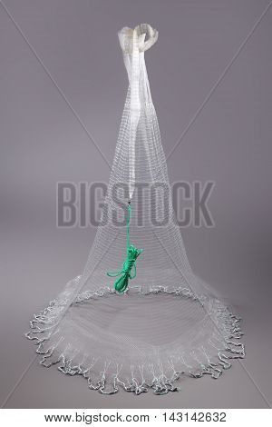 Harvest fishing tackle hand-cast nets on grey background