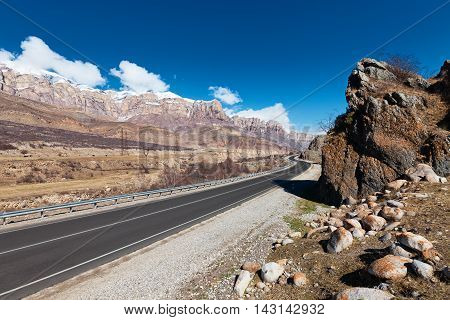 Landscape with empty road through scenic canyon