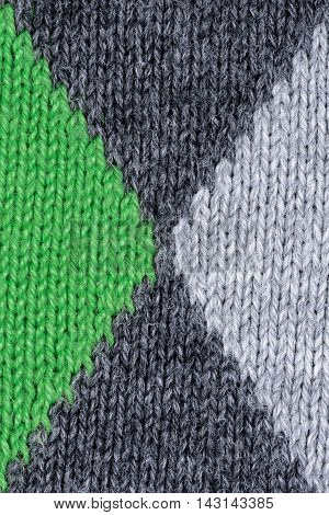 Green and gray woolen decorative fabric texture background, close up