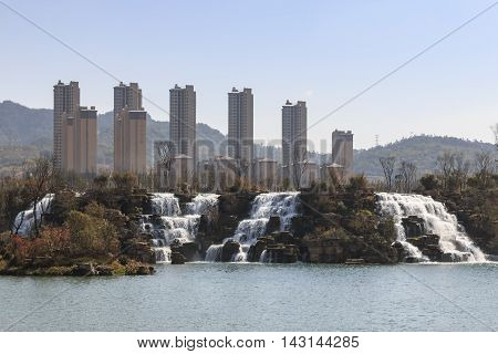 Kunming China - March 4 2016: Kunming Waterfall park featuring a 400 meter wide manmade waterfall. Kunming is Yunnan's capital