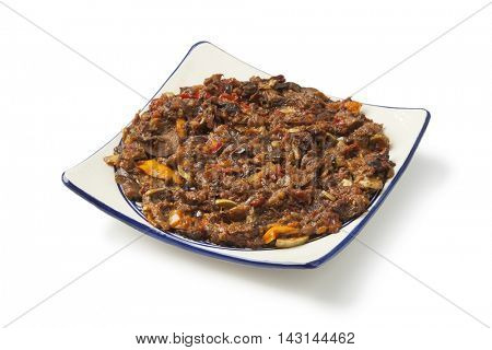 Moroccan fresh eggplant and bell pepper salad on white background