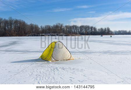 Tent of winter fisherman on a frozen river Dnepr in Dnepropetrosvk city Ukraine