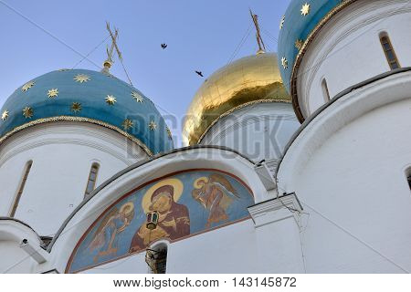 Sergiev Posad, Russia - August 29, 2015: Gold and blue dome over the Cathedral of the Trinity-Sergius Lavra. The Shrine of all Christians. The center of pilgrimage of the Christian world. Sergiyev Posad is included into the Golden ring of Russia.
