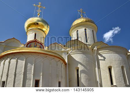 Sergiev Posad, Russia - may 28, 2016: The Golden dome over the Cathedral of the Trinity-Sergius Lavra. The Shrine of all Christians. The center of pilgrimage of the Christian world. Sergiyev Posad is included into the Golden ring of Russia.