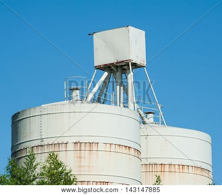 White silos for the storage of lime and cement