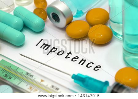 Impotence - diagnosis written on a white piece of paper. Syringe and vaccine with drugs.