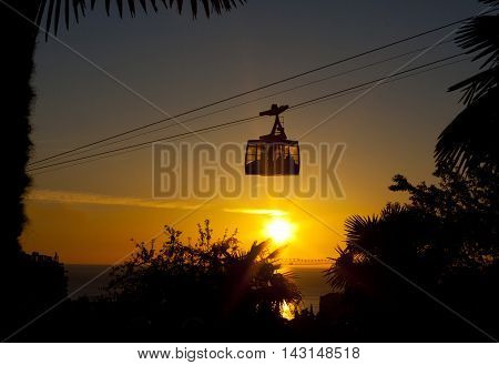 cableway sunset cable cabin on the sea coast