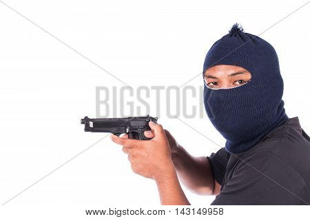 Bandit with gun in hand on white background