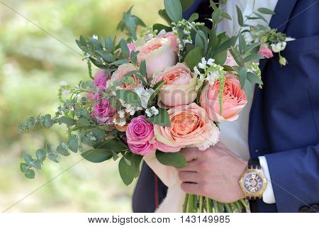 Groom Holding A Beautiful Bridal Bouquet. Wedding Bouquet Of Peach Roses By David Austin,  Single-he