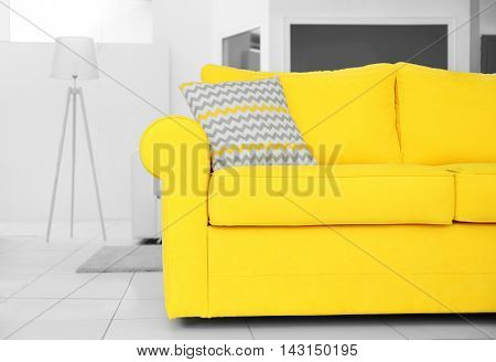 Yellow couch for sale in furniture store