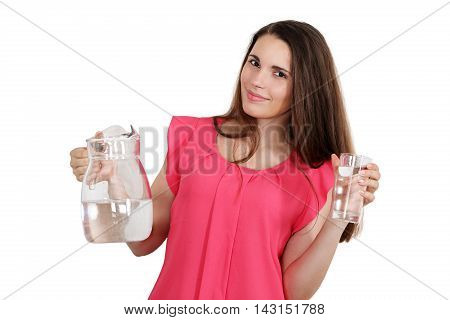 Beautiful woman holding a jug of water and a glass. Isolated on white