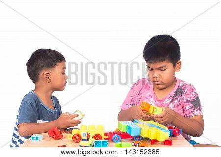 Two little asian boy play building brick