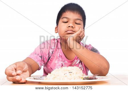 Cute little boy bored with food on white background