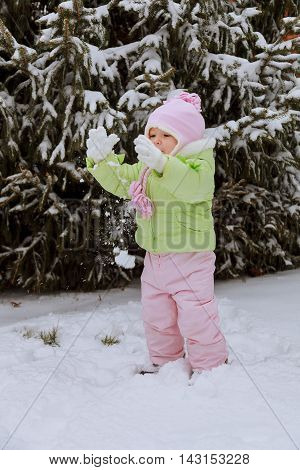 Little girl playing with snow beautiful little girl playing with snow