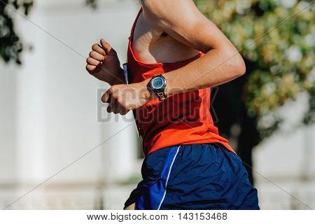 closeup hand watch men athlete runner marathon