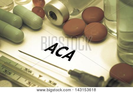 ACA (affordable care act). Treatment and prevention of disease. Syringe and vaccine. Medical concept. Selective focus