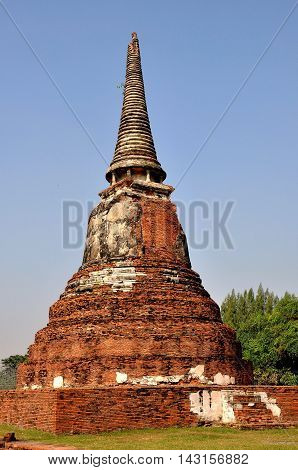 Ayutthaya Thailand - December 20 2010: Ruins of a bell-shaped brick Chedi with a ringed spire at the Royal Wat Mahathat