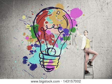Young woman in casual drawing creativite idea concept on wall