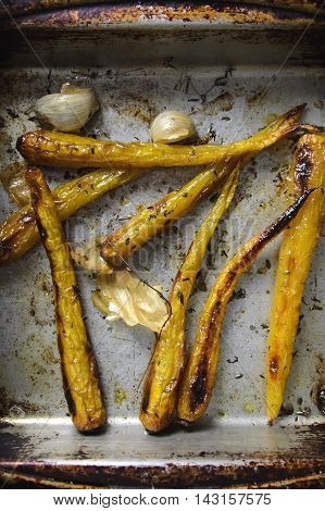 Roasted herritage carrots with garlic and herbs.