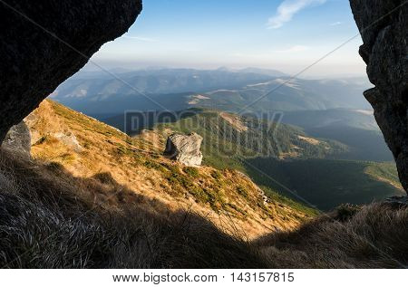 Beautiful stone on a slope. Mountain landscape. Sunny day in autumn. Carpathian mountains, Ukraine, Europe. Beautiful nature