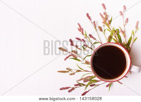 Cup of coffee with pink flowers on a white background top view good morning set