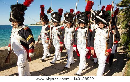 Ajaccio city Corsica island France-August 13 2016: The reenactors dressed as Napoleonic soldiers for celebration the Napoleon birthday who was born in Ajaccio.