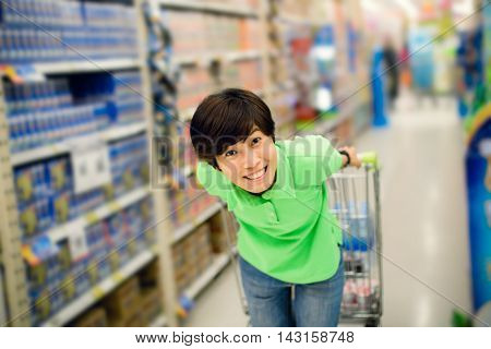 Beautiful asian woman so happy shopping in a supermarket