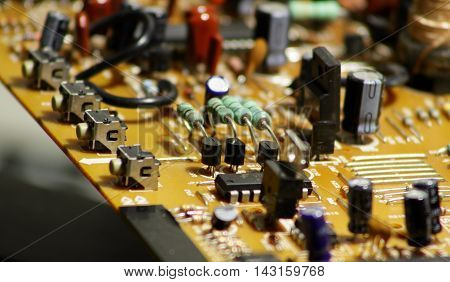 Printed electronic board with soldered radio components macro shot stock image