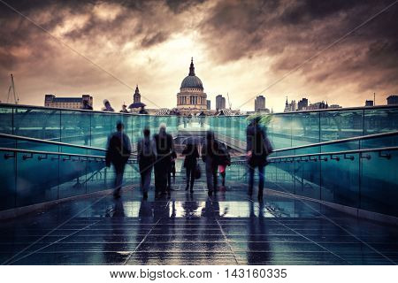 St Paul's Cathedral in the rain, as seen from the south bank of the Thames, looking across the Millennium Bridge.