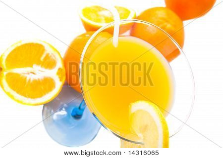 Wine glass with orange juice and fruit
