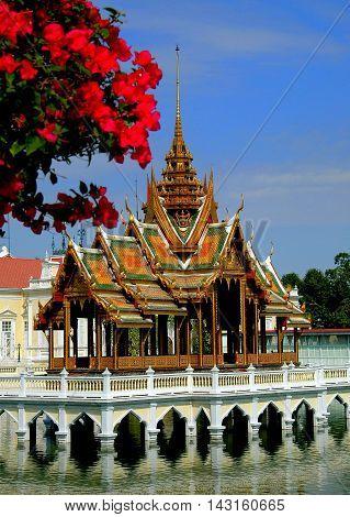 Bang Pa-In Thailand - December 28 2005: Bougainvilleas frames the Golden Pavilion Phra Thinang Aisawan Tippaya at the Royal Summer Palace