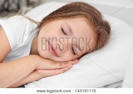 Adorable sleeping little girl, close up
