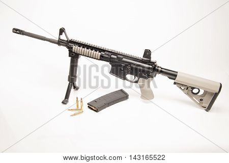 Las Vegas NV USA - January 25 2016: Profile of Daniel Defense AR-15 semiautomatic rifle with custom Larue grips and stock and .223 ammunition and 30 round magazine.