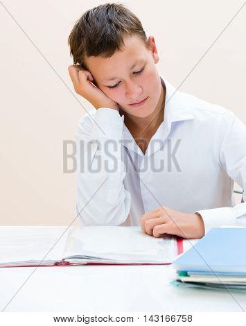 Sad Schoolboy At The Desk