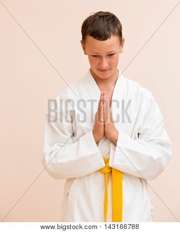 Boy studying martial arts Folded the palm