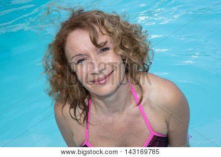 Portrait Attractive Mature Woman In Bikini In Pool.