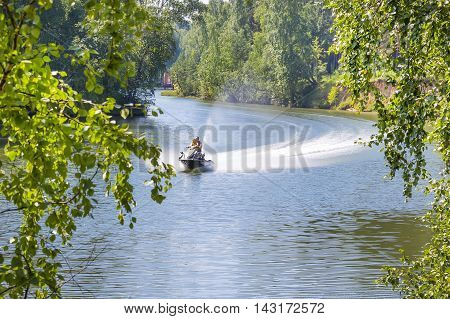 The river Separate the town of Berdsk Novosibirsk oblast Siberia Russia - August 7 2016: vacationers go on a water bike in a small Siberian river
