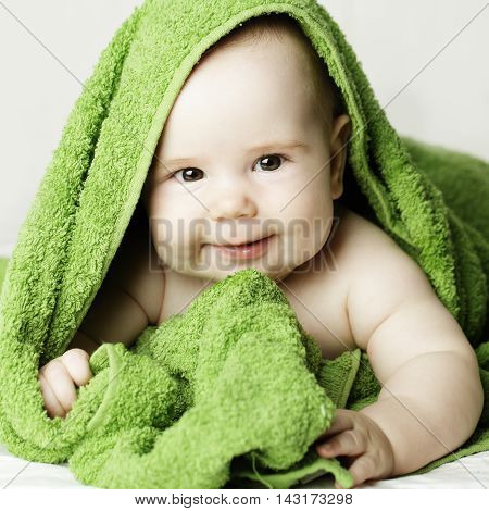 Smiling beautiful baby after bath 4 months