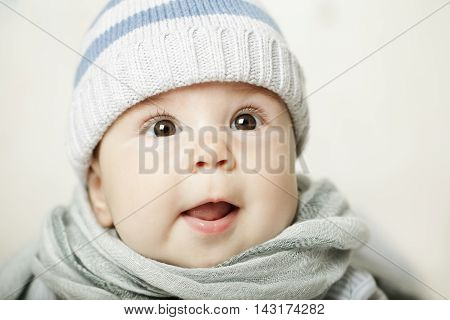 Cute surprised little beautiful baby looking up