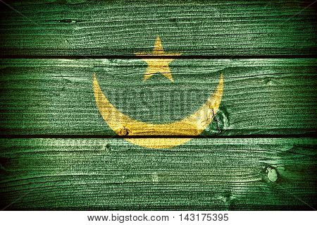 flag of Mauritania painted on old grungy wooden background: 3d illustration