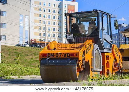 Roller For Laying Asphalt And Other Road Equipment On The Pavement On A Clear Day. City Cheboksary,