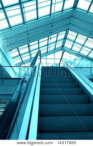 high-speed blue moving escalator inside shopping mall