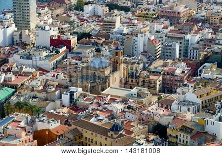 Co-cathedral Saint Nicolas of Bari in Alicante hidden between the houses, summer Spain