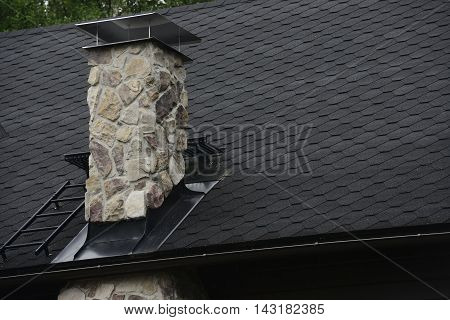stone chimney on the roof of cottage